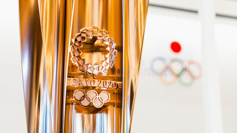 Tokyo, Japan - Nov 1, 2019: Gold trophy cup of Tokyo Summer Olympic 2020 show in Japan Olympic Museum, with Olympic games logo stock photography