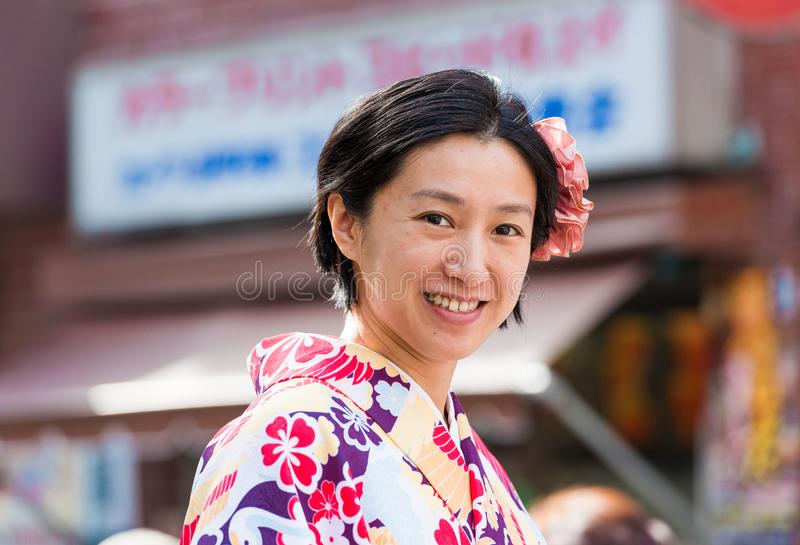 TOKYO, JAPAN - NOVEMBER 7, 2017: Portrait of a woman in a kimono. Close-up. TOKYO, JAPAN - NOVEMBER 7, 2017: Portrait of a woman in a kimono. Close-up royalty free stock images