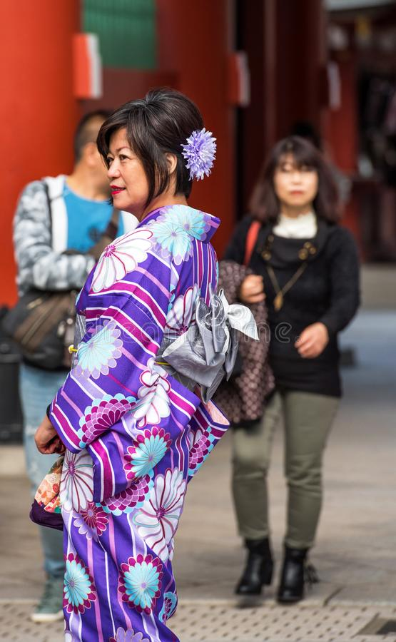 TOKYO, JAPAN - NOVEMBER 7, 2017: Woman in a kimono near the temple Asakusa Schrein Senso-ji. Vertical.  royalty free stock photos