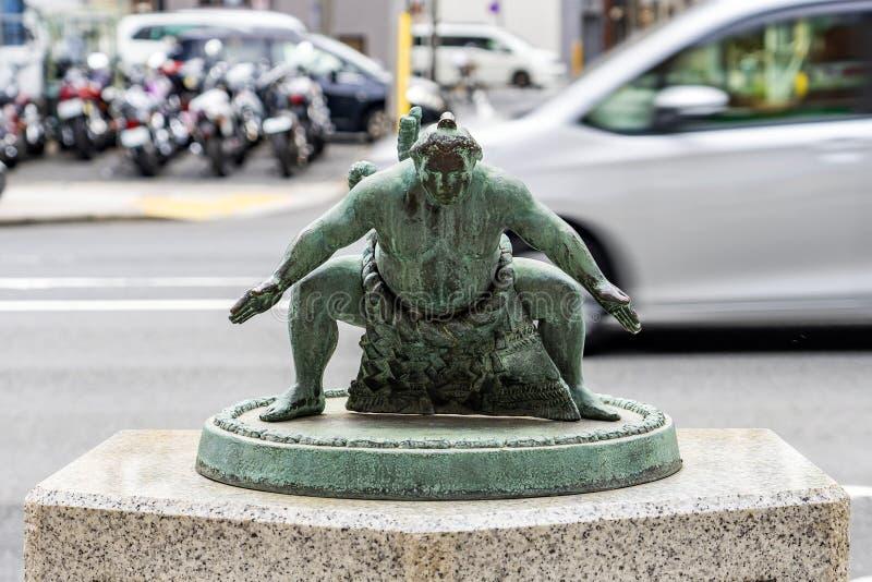 The Bronze Figure Statue Of Japanese Sumo Wrestler. TOKYO, JAPAN - OCTOBER 8, 2018. The Bronze Figure Statue Of Japanese Sumo Wrestler on the Street stock photos
