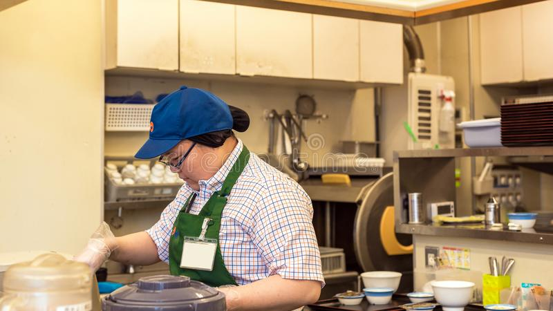 TOKYO, JAPAN - OCTOBER 31, 2017: Cook in the kitchen is cooking. Copy space for text. royalty free stock photography