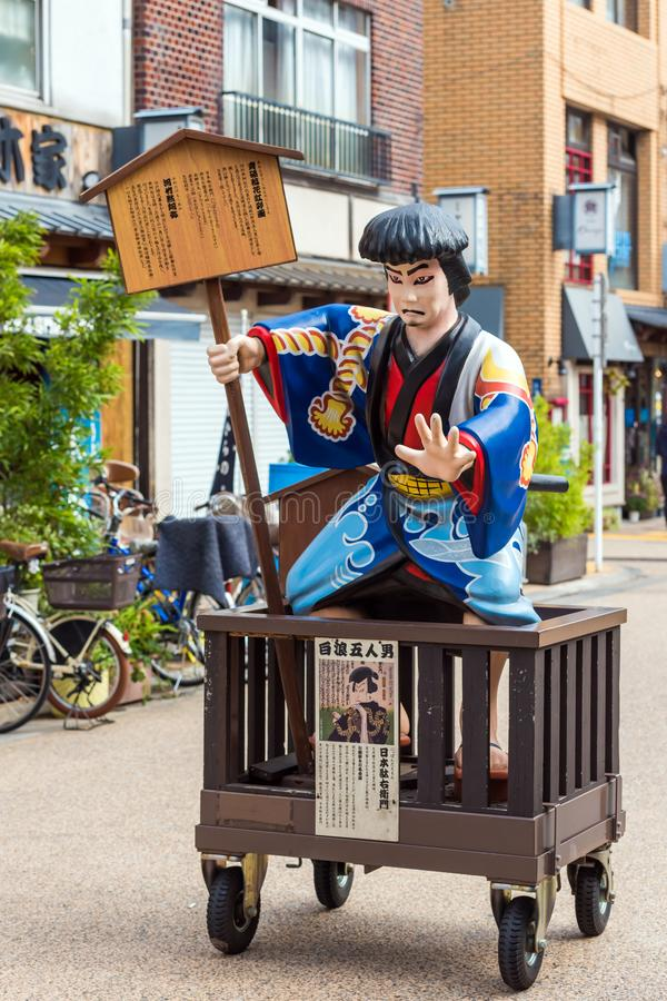 TOKYO, JAPAN - OCTOBER 31, 2017: Statue of a Japanese peasant in traditional medieval period costume on street near to Sensoji tem stock images
