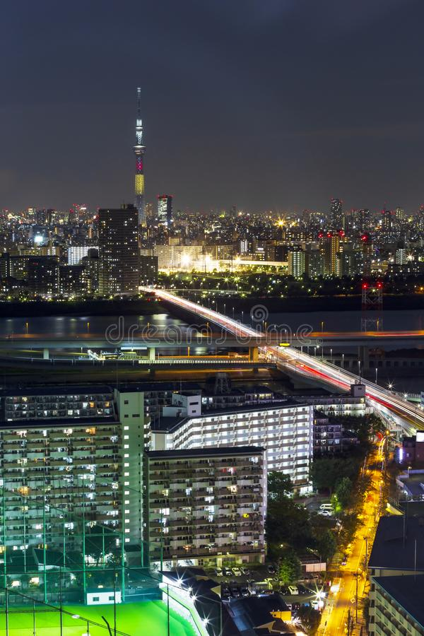 Tokyo skytree tower in Janpan in night light with brigde and building. TOKYO ,JAPAN - OCTOBER 12: Tokyo skytree tower in Janpan at twilight, OCT 12,2016, Tokyo royalty free stock photography