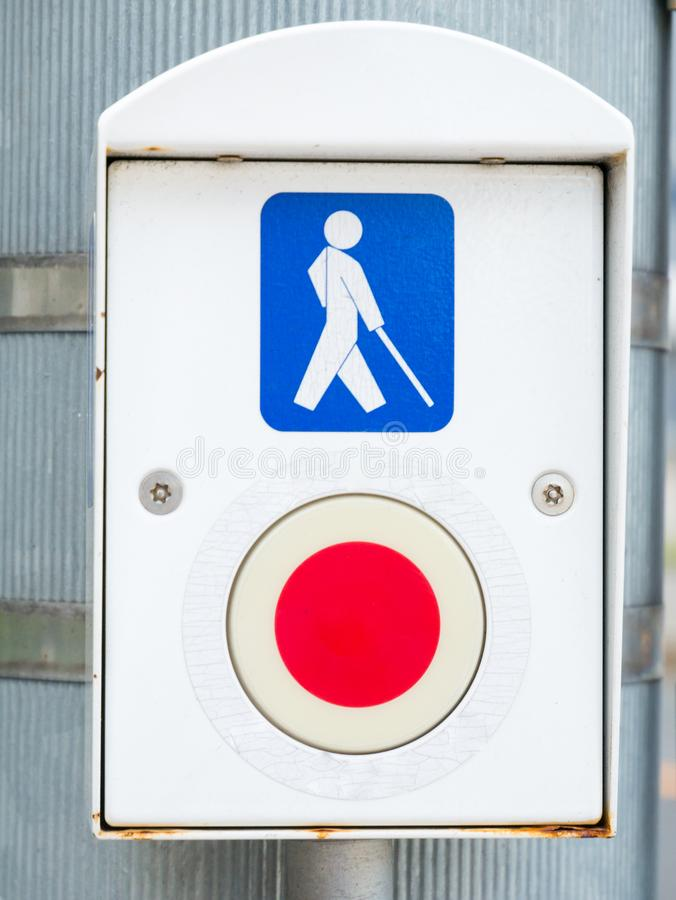 Tokyo, JapanTraffic light button for pedestrians and handicapped persons / Symbol for disabled person for crossing the road at the royalty free stock photography