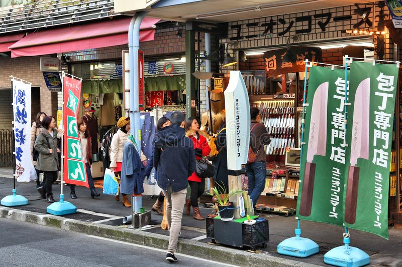 Tokyo knife stores. TOKYO, JAPAN - DECEMBER 4, 2016: People visit Kappabashi area of Asakusa in Tokyo, Japan. Kappabashi Street is known for its multiple stores stock photography