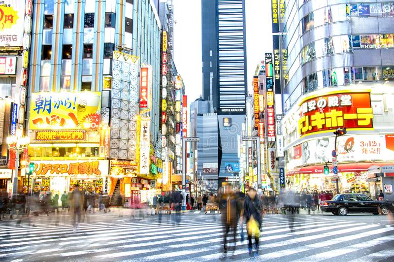 TOKYO - MARCH 2, 2015: everyday life with blurred commuters at rush hour on centra road in Kabuki district - International capital royalty free stock image