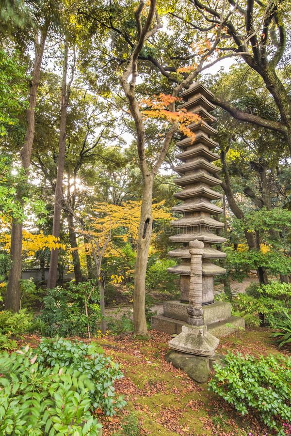 Tokyo Metropolitan Park KyuFurukawa japanese garden`s ruins of a giant thirteen storied stone pagoda Kuyoto stock photography