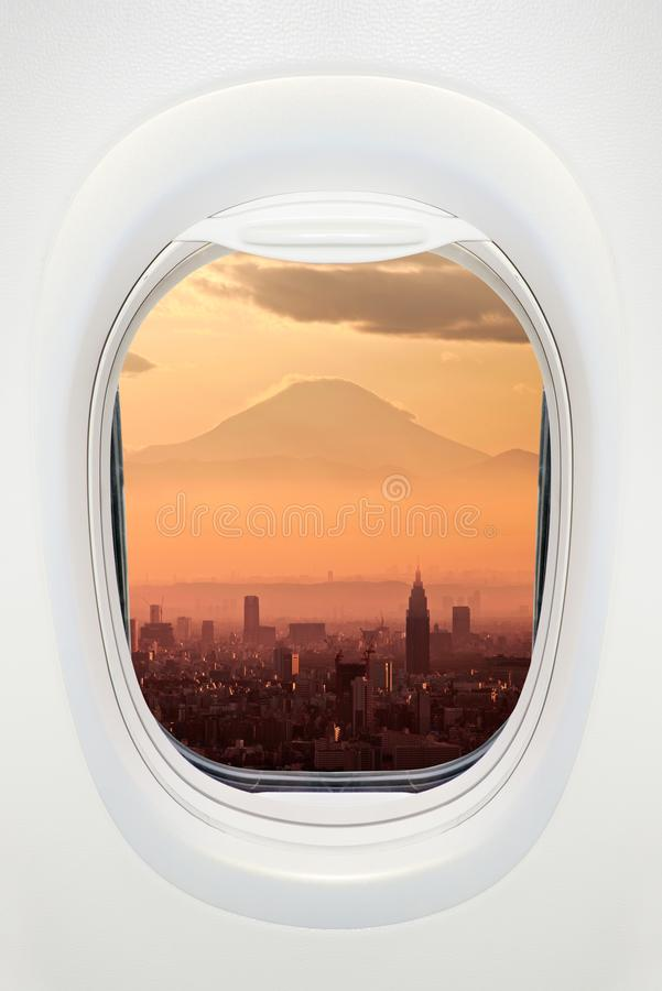Tokyo and Mount Fuji at night seen through the window of airplane, travel in Japan concept. Tokyo and Mount Fuji at night seen through the window of airplane stock images