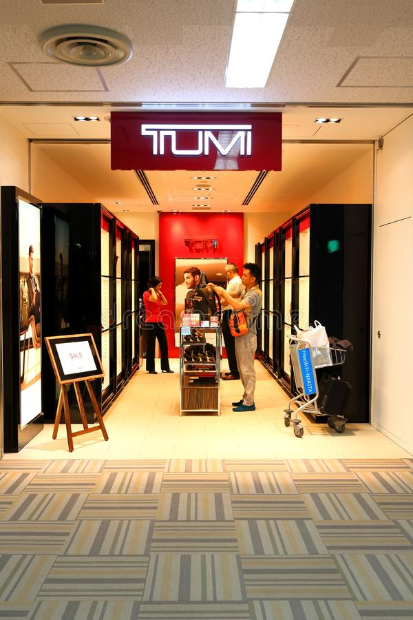 Tokyo: Narita airport after immigration check in retail area. Tumi retail store after check in , at Narita international airport T2. Shopper shopping in the royalty free stock images