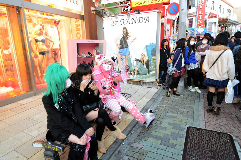 TOKYO - NOV 24 2013: Japanese girls in cosplay outfit gather around Harajuku train station in Tokyo stock photo
