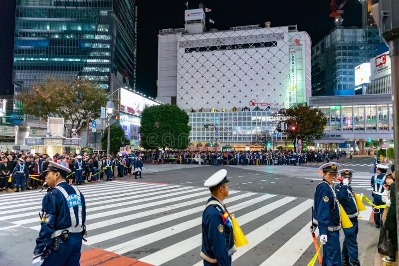 Tokyo policeman on duty at Shibuya crossing during Halloween celebration. stock photography