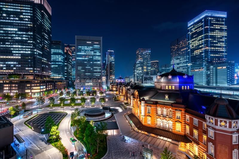 Tokyo railway station and business district building at night, Japan.  royalty free stock image