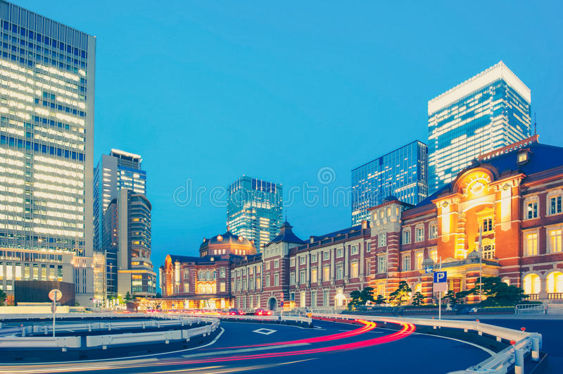Tokyo railway station and Tokyo highrise building royalty free stock photo