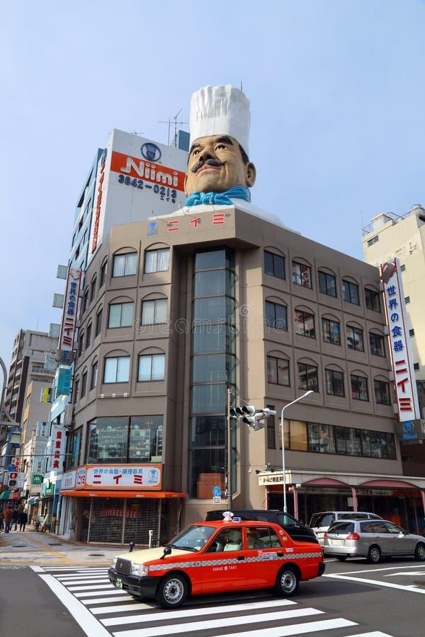 Tokyo restaurant shopping. TOKYO, JAPAN - DECEMBER 4, 2016: People visit Kappabashi area of Asakusa in Tokyo, Japan. Kappabashi Street is known for its multiple royalty free stock photography