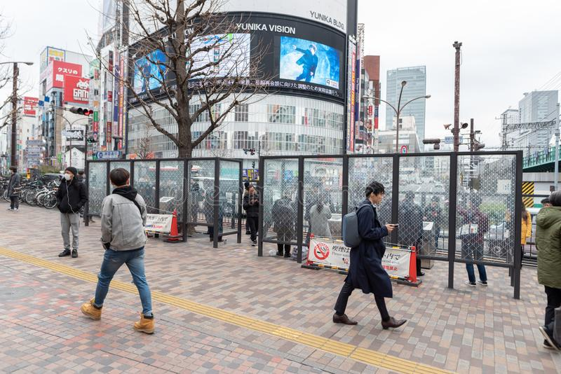 TOKYO, JAPAN - FEBRUARY 5, 2019: Tokyo Shinjuku Area with Smoking People. Smoking Area Outside. Japan. Tokyo Shinjuku Area with Smoking People. Smoking Area royalty free stock photos