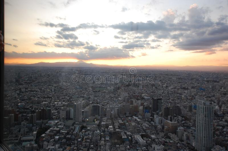 Tokyo skyline with Mount Fuji at sunset. View of Tokyo city with Mount Fuji in the distance at sunset stock images
