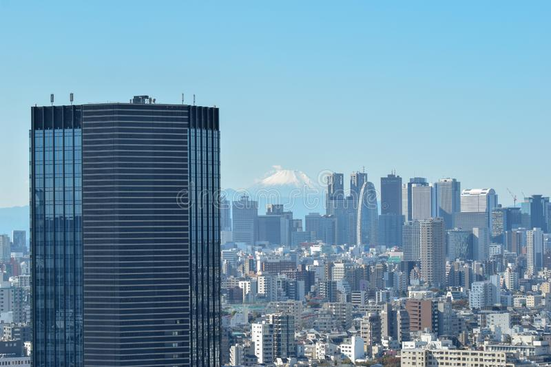Tokyo Skyline and Mt Fuji. Cityscape shot of Tokyo from high, with a large mordern skyscraper in the foreground and Mt. Fuji in the distance in the centre stock image