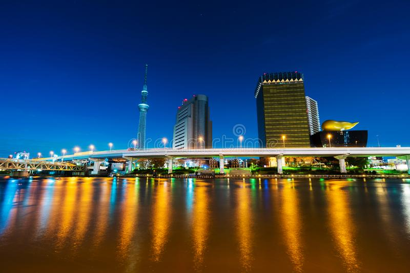 Tokyo skyline on Sumida River at night, Japan stock images