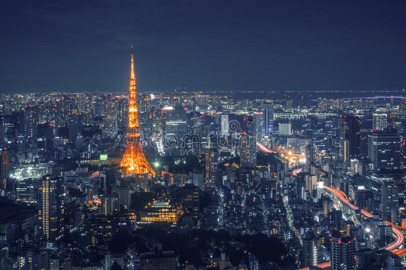 Tokyo Skyline and view of skyscrapers on the observation deck at night time in Japan stock photo