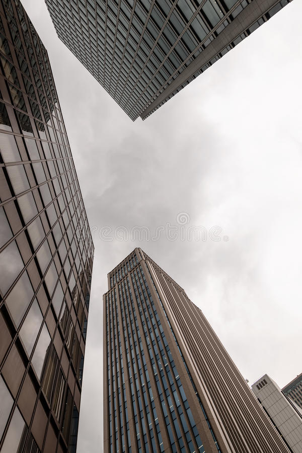 Tokyo skyscrapers. Under overcast sky frog perspective royalty free stock image