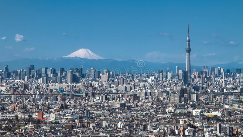 Tokyo Skytree and Mt Fuji. A clear city view of Tokyo with office buildings, Tokyo Skytree and Mt Fuji stock photos