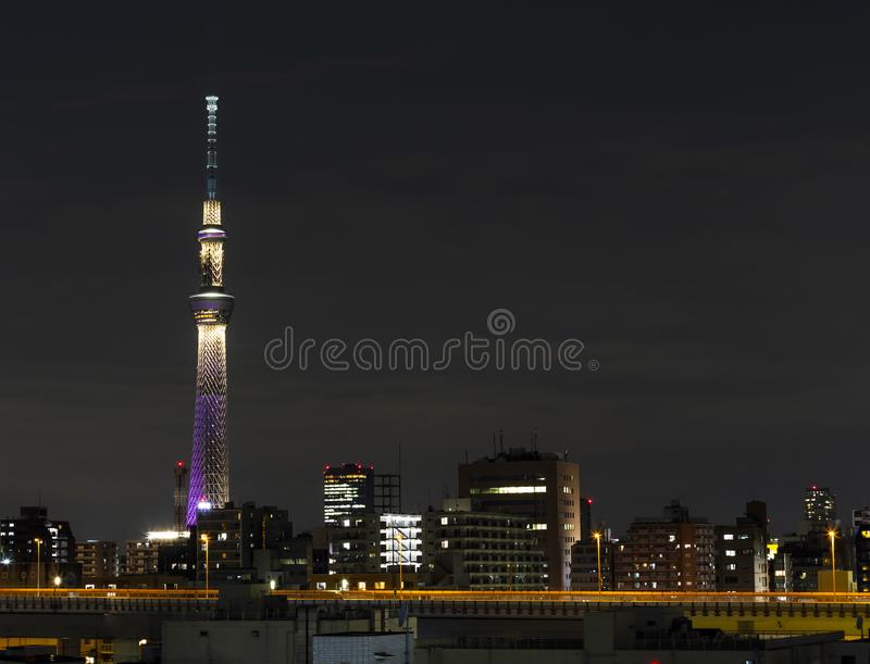Tokyo skytree tower in Janpan in night light with brigde and building. TOKYO ,JAPAN - OCTOBER 12: Tokyo skytree tower in Janpan in night light , OCT 12,2016 stock image