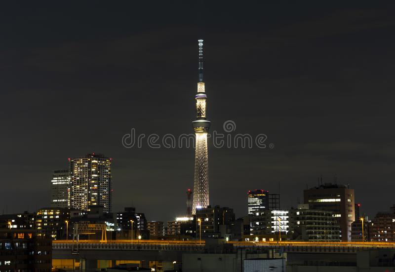 Tokyo skytree tower in Janpan in night light with brigde and building. TOKYO ,JAPAN - OCTOBER 12: Tokyo skytree tower in Janpan in night light , OCT 12,2016 royalty free stock photography