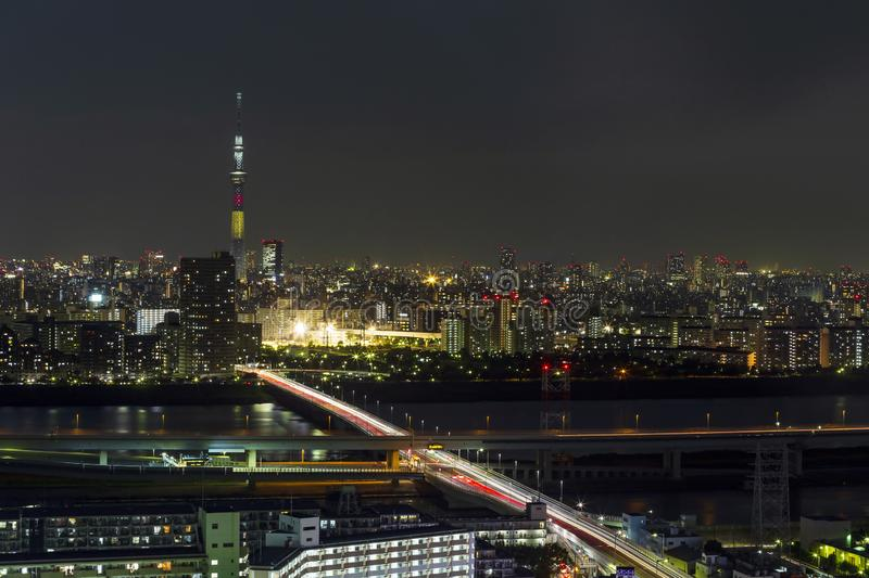 Tokyo skytree tower in Janpan in night light with brigde and building. TOKYO ,JAPAN - OCTOBER 12: Tokyo skytree tower in Janpan at night light, OCT 12,2016 stock photo