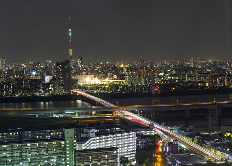 Tokyo skytree tower in Janpan in night light with brigde and building. TOKYO ,JAPAN - OCTOBER 12: Tokyo skytree tower in Janpan at night light, OCT 12,2016 stock image