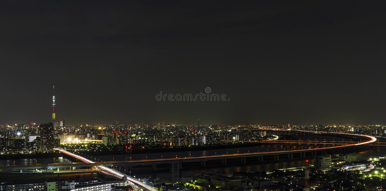 Tokyo skytree tower in Janpan in night light with brigde and building. TOKYO ,JAPAN - OCTOBER 12: Tokyo skytree tower in Janpan at night light, OCT 12,2016 royalty free stock images