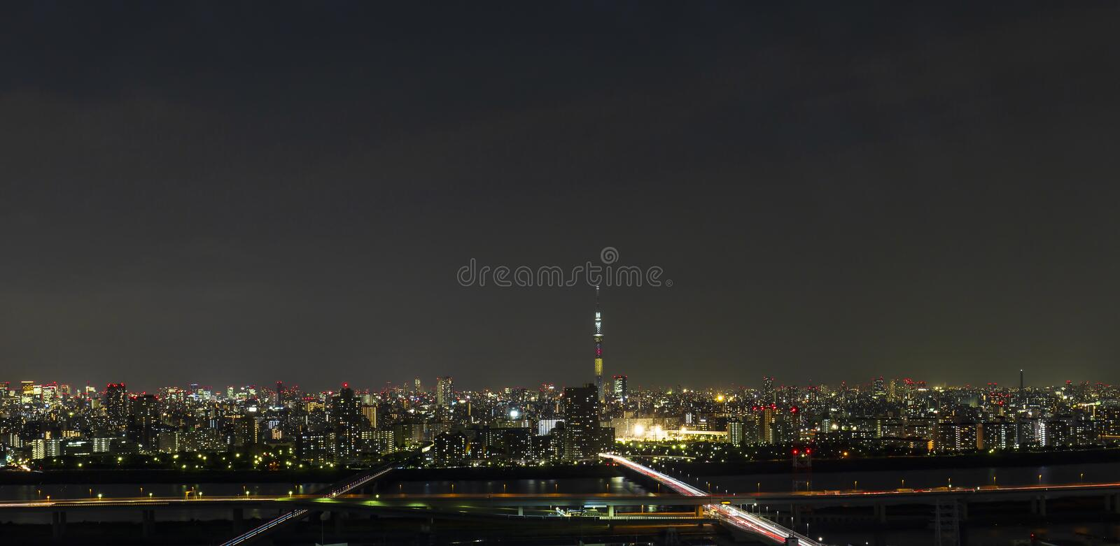 Tokyo skytree tower in Janpan in night light with brigde and building. TOKYO ,JAPAN - OCTOBER 12: Tokyo skytree tower in Janpan at night light, OCT 12,2016 stock images