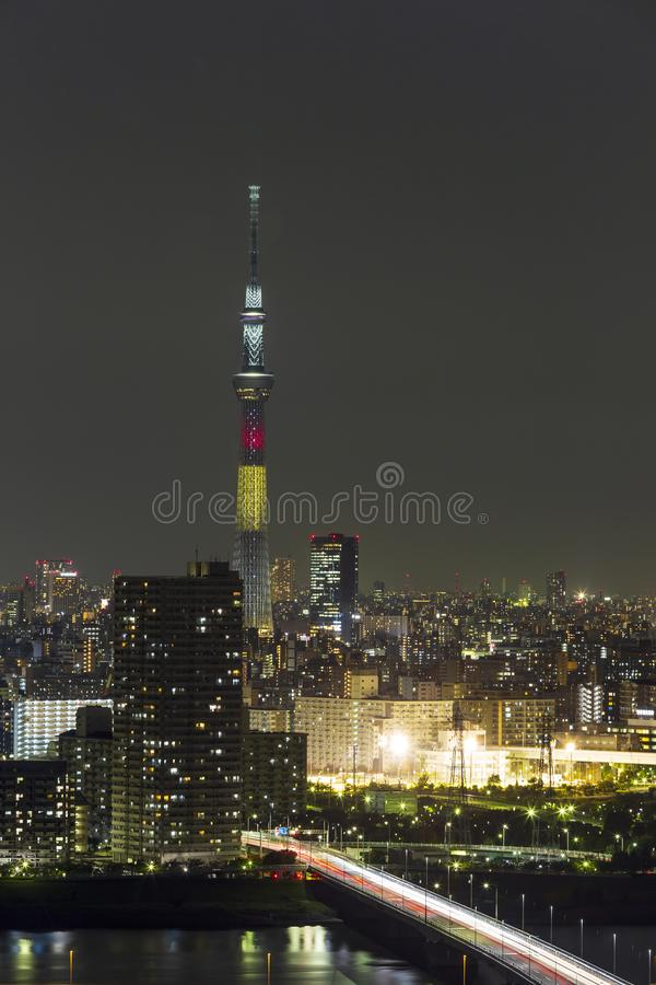 Tokyo skytree tower in Janpan in night light with brigde and building. TOKYO ,JAPAN - OCTOBER 12: Tokyo skytree tower in Janpan at twilight, OCT 12,2016, Tokyo royalty free stock images