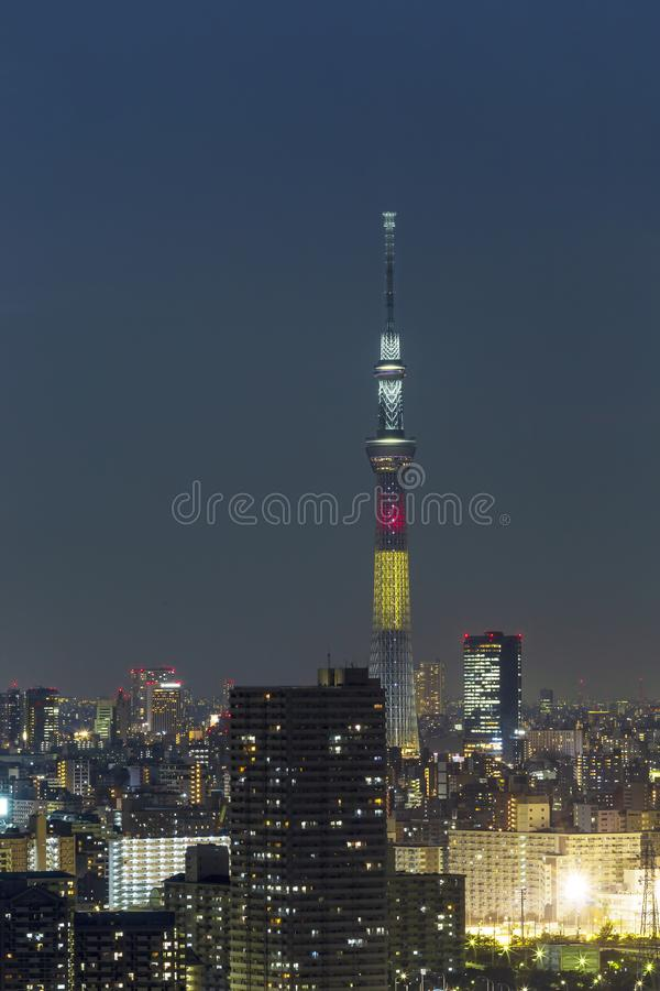 Tokyo skytree tower in Janpan in night light with brigde and building. TOKYO ,JAPAN - OCTOBER 12: Tokyo skytree tower in Janpan at twilight, OCT 12,2016, Tokyo royalty free stock photos