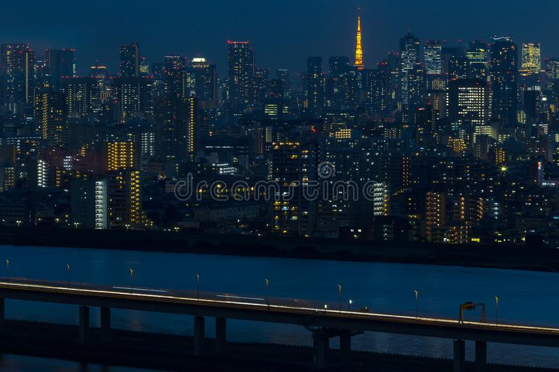 Tokyo tower in Janpan in night light with brigde and building. Tokyo tower in Janpan at twilight and Tokyo city building royalty free stock photography