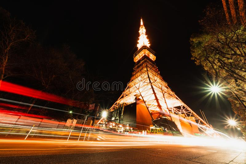 Tokyo tower at night with traffic light trails. Japan iconic symbol, Asia travel destination, Japanese tourism concept. Tokyo tower at night with traffic light stock photography