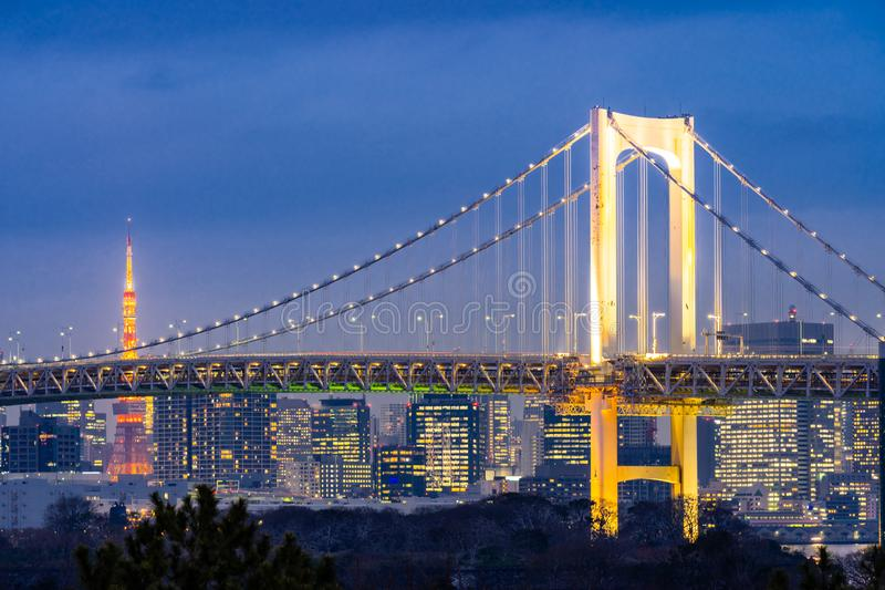 Tokyo tower with rainbow bridge sunset royalty free stock images