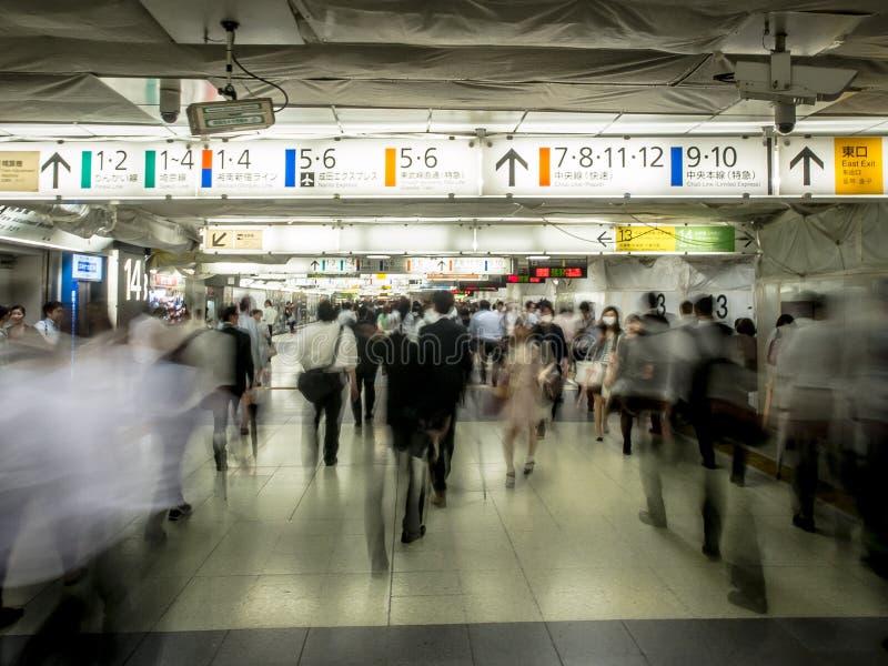 Tokyo Train Station Underpass Crowds. Crowds of passengers passing through Shinjuku Station in Tokyo