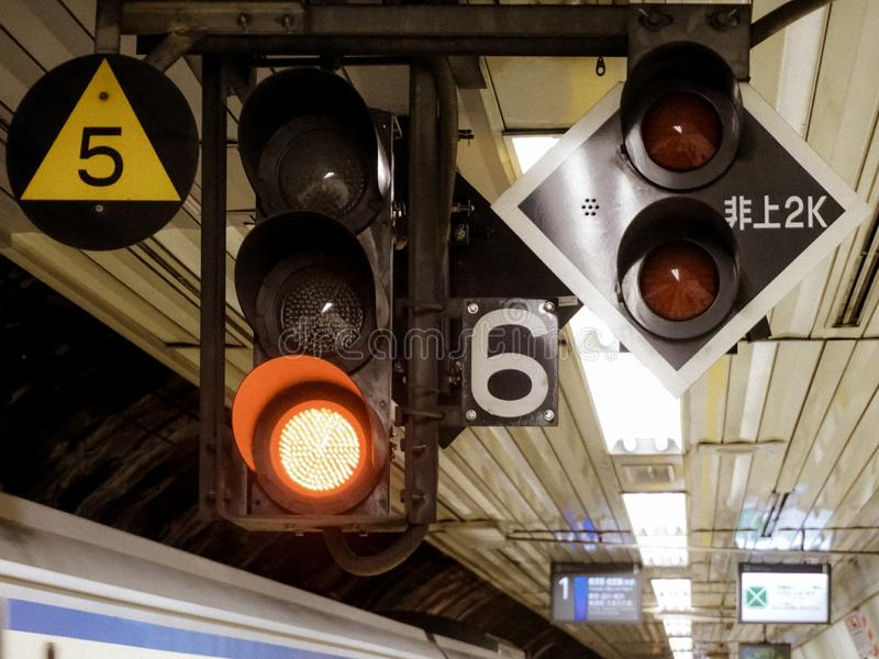 Tokyo train traffic light in station. Tokyo station train subway traffic lights and signs japan stock photos