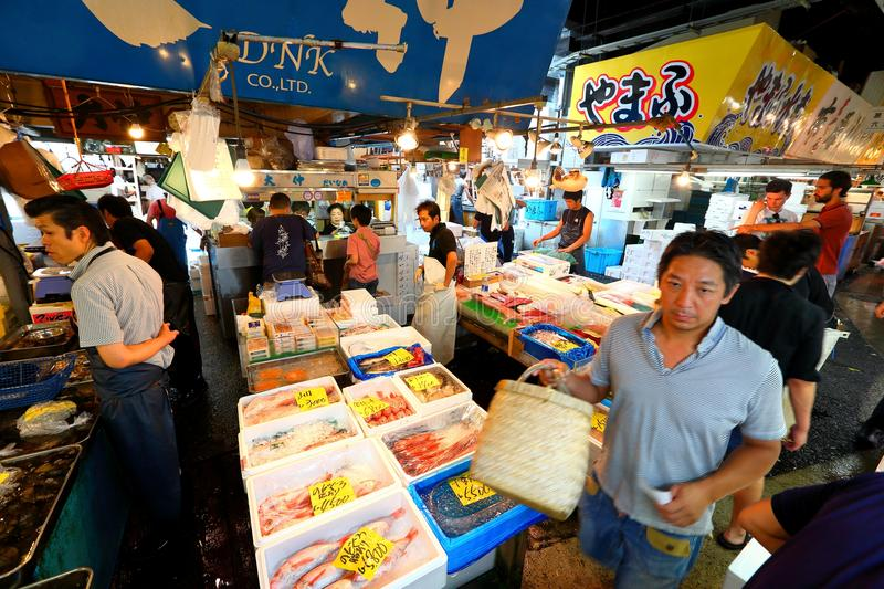 Tokyo: Tsukiji Seafood Fish Market. Workers selling fresh seafood at the Tsukiji Wholesale Seafood and Fish Market in Tokyo Japan. Locals and tourist visit the stock photos
