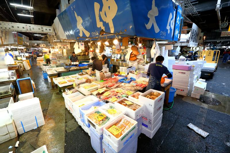 Tokyo: Tsukiji Seafood Fish Market. Workers selling fresh seafood at the Tsukiji Wholesale Seafood and Fish Market in Tokyo Japan. Locals and tourist visit the stock image