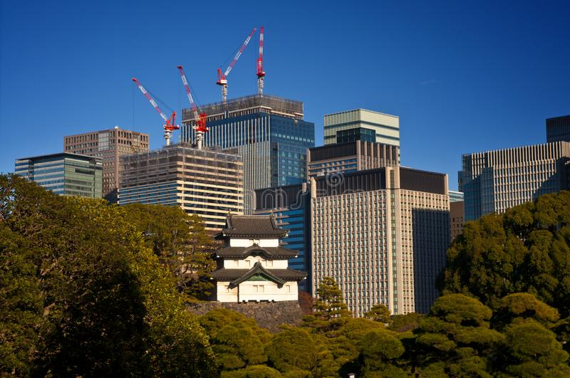 Tokyo - where tradition meets modernity. View of the remainings of old Edo castle against the high-rising downtown stock photos