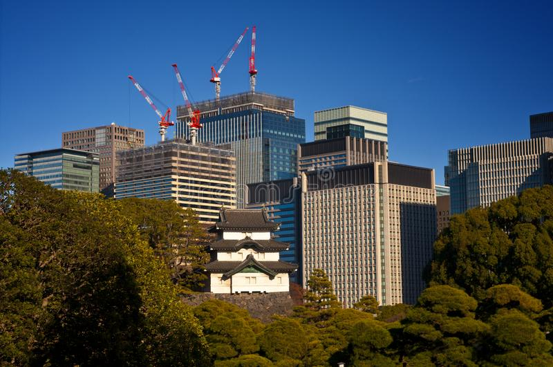 Tokyo - where tradition meets modernity. View of the remainings of old Edo castle against the high-rising downtown royalty free stock images