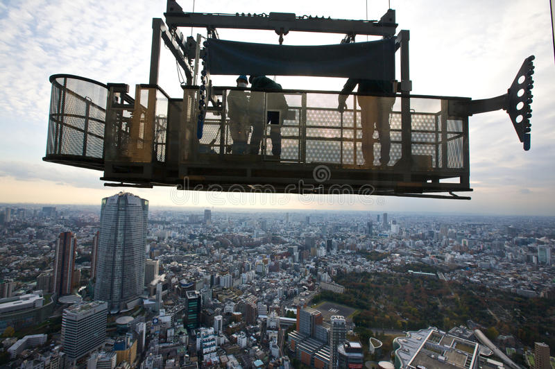 Tokyo Window Washers. View of window washers 53 stories up on Tokyo building with Tokyo downtown skyline in background stock image