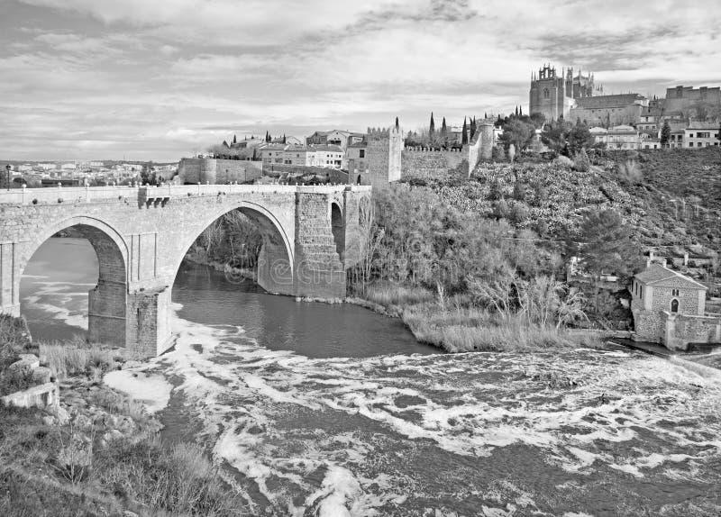 Toledo - Look to San Martin s bride or Puente de san Martin to Monastery of saint John of the King. In morning light royalty free stock photos