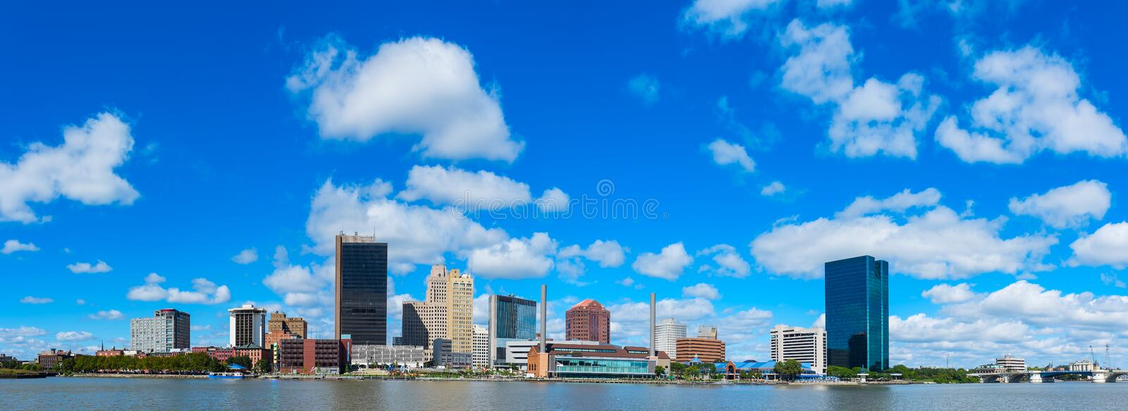 Toledo. Panoramic view of Toledo downtown skyline with blue sky and white clouds, Ohio stock image
