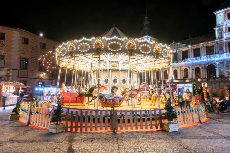Toledo, Spain - December 14, 2018: Carousel and people enjoying christmas time in Toledo cathedral square stock photos