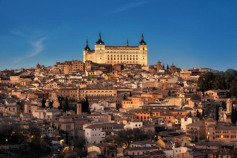 Toledo, Spain old town cityscape and Alcazar at dusk royalty free stock images
