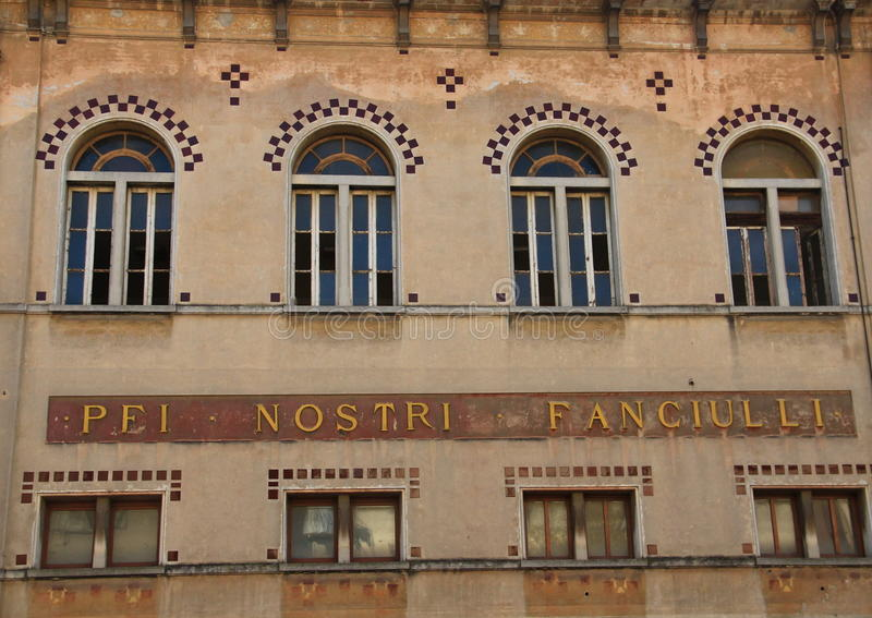 Tolentino, Italy: front of a building and windows. The shot shows a front of a building and architectural windows in Tolentino, Marche, Italy royalty free stock images