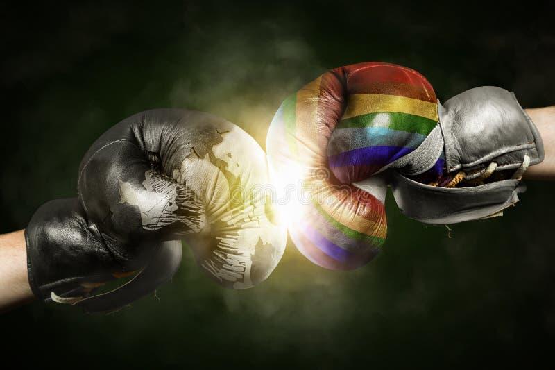 Tolerancia contra Intolerancia simbolizada con los guantes de boxeo imagen de archivo