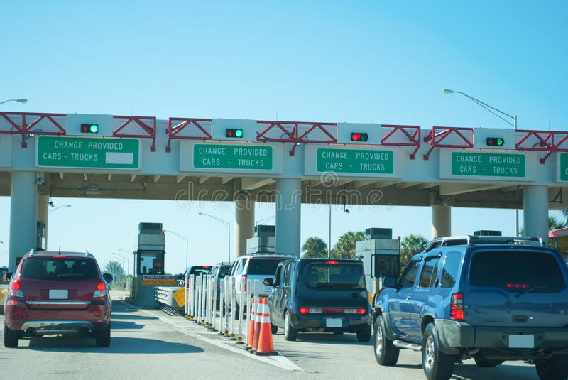 Toll booths pay station with cars waiting in line. To pay on a sunny morning royalty free stock photos